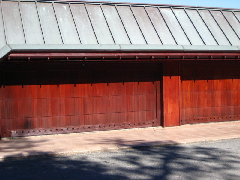 These garage doors will bring instant beauty to your home for Composite wood garage doors