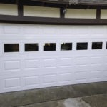 REPLACE DAMAGED SECTIONS-REPLACED GARAGE DOOR SECTIONS