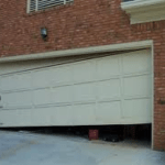 GARAGE DOOR OFF TRACK STAGE 4- 3 ROLLERS OUT, CABLES OFF DRUMS. CALL NOW! 190.00 AFTER DISCOUNTS