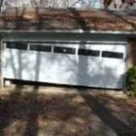 GARAGE DOOR OFF TRACK STAGE 3- 2 ROLLERS OUT CABLE OFF DRUM. CALL NOW!