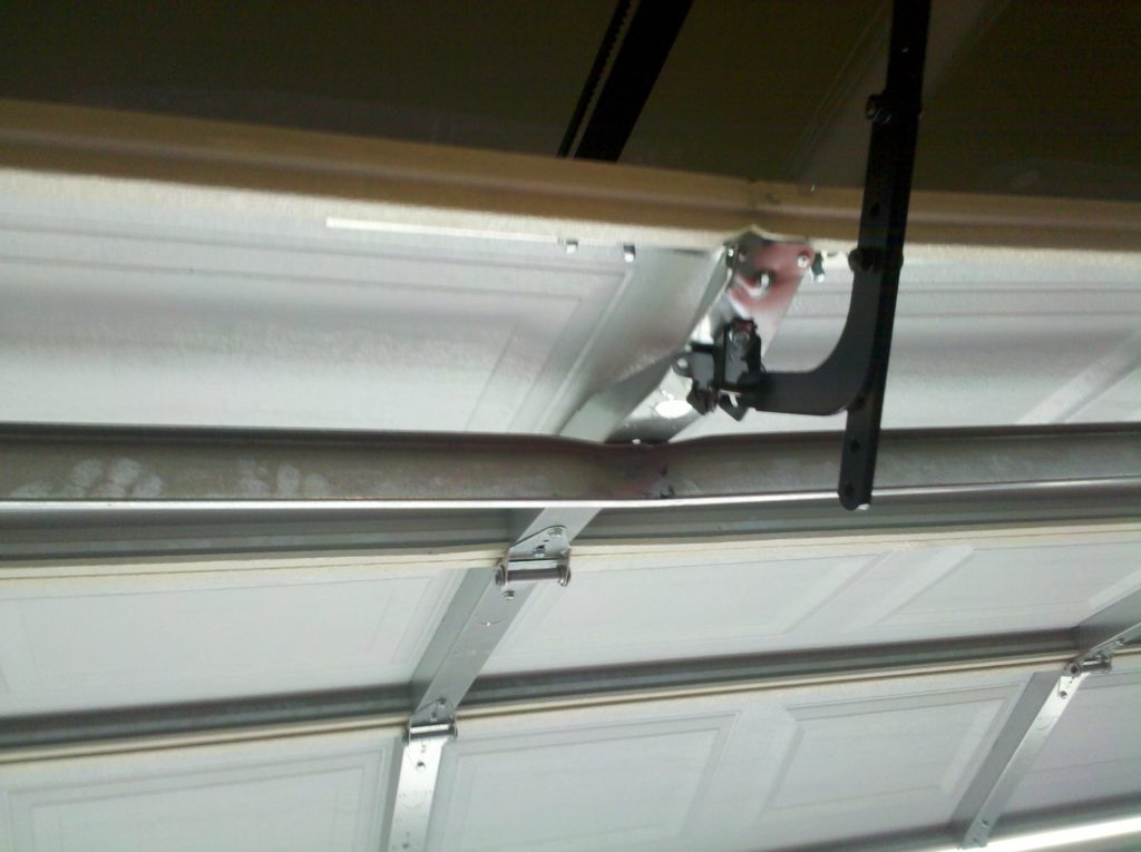 Damaged Garage Door Section No OP Bracket and Strut Installed Wrong