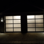 FULL VIEW GARAGE DOOR AT NIGHT INSTALLED BY ONE CLEAR CHOICE GARAGE DOORS